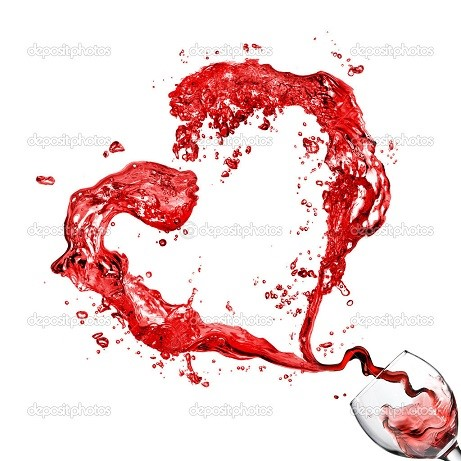 Heart from pouring red wine in glass goblet isolated on white